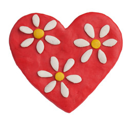 Red plasticine heart with plasticine daisies