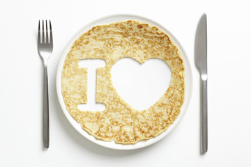 Pancake with love heart shape cut out