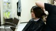 Young man sits in hairdressing salon in seat to make hairdress