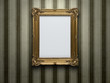 Blank gold picture frame at grunge wall