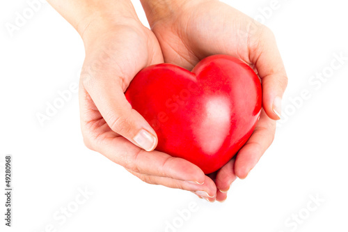 Heart in hands as love and health symbol