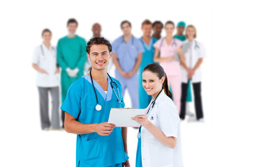 Nurse and doctor holding clipboard and smiling