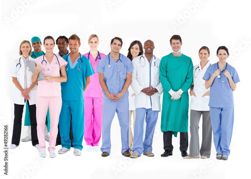 Smiling medical team of doctors nurses and surgeons
