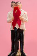 Gay groom cake toppers with aids awareness ribbon