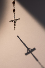 Crucifix casting a shadow