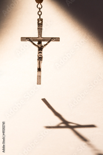 Cross casting a shadow