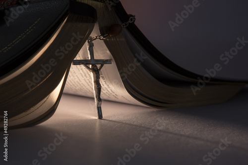 Crucifix propping open the bible