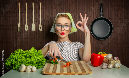 Happy woman cook with okay sign