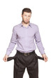 Young Handsome Businessman With Empty Pockets On White