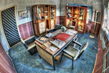 Old forgotten desk in an abandoned office