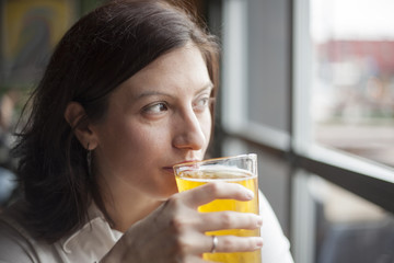 Young Woman Drinking a Pint of Hard Cider