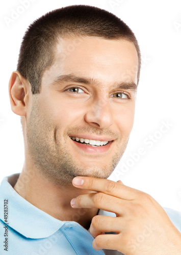 Cheerful thinking young man, over white