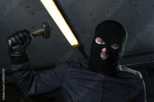 masked criminal with hammer