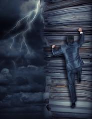 Businessmen climbing up at storm