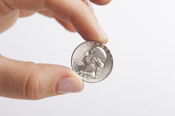 Hand Holding Quarter