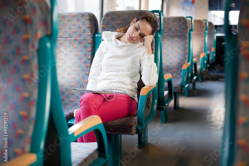 Young woman sleeping on the train