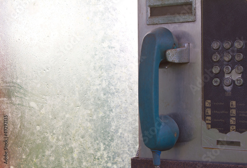 Old blue phone in phone booth coin,Buttons are disabled .