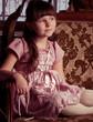 Beautiful little girl in pink dress in vintage style