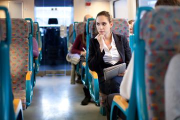 Pensive businesswoman on the train