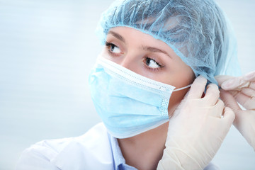 female doctor in medical gloves