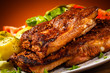 Tasty grilled ribs with vegetables