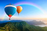 Fototapety Colorful hot-air balloons flying over the mountain