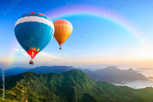 Colorful hot-air balloons flying over the mountain - 49297754