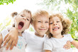 Low angle view portrait of funny children