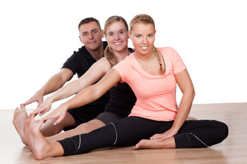 Three friends working out in a gym