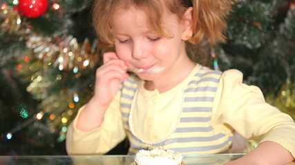 The girl is eating a cake
