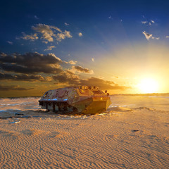 army vehicle in a desert at the sunset