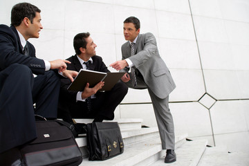 Male businessmen on steps