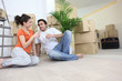 Couple moving in to flat drinking champagne
