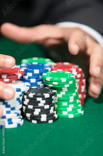 Poker player raking a big pile of chips