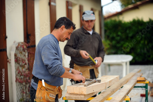 Two carpenters working on the same job
