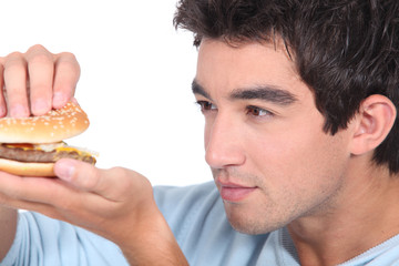 portrait of a young man with hamburger