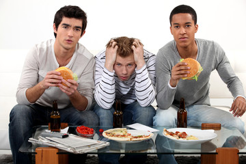 Boys eating burgers