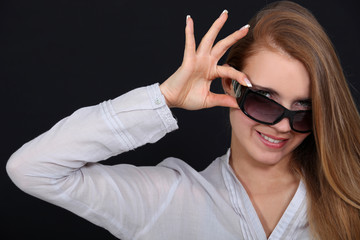 Woman tipping sunglasses