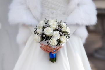 bride hands holding beautiful wedding bouquet