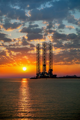 Sea oil rig on sunrise.