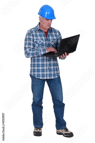 Builder with a laptop