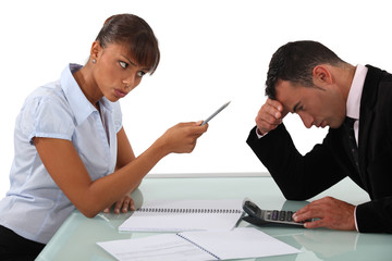 businessman and female colleague in disagreement
