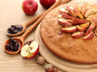 tasty homemade pie with apples and jam, on wooden table