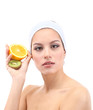 Young woman with fruit.Concept: Facial fruit masks. Isolated