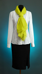 White blouse, black skirt and green scarf