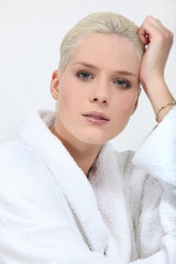 Stunning blonde woman in full make up and a toweling robe
