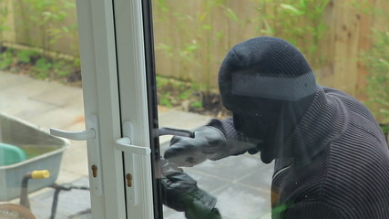 Burglar breaking open the door