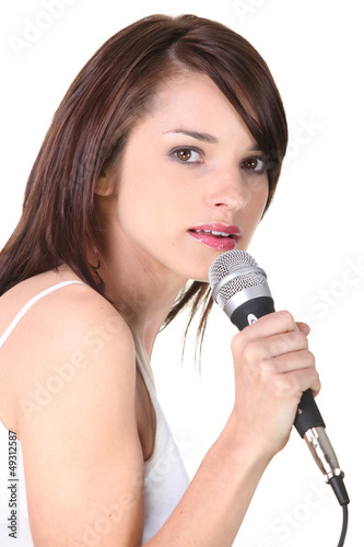 female would be singer holding microphone