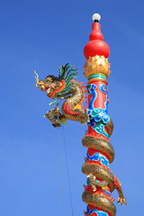 Chinese dragon with lamp decorated on the red post