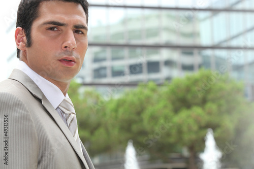 Young businessman looking concerned